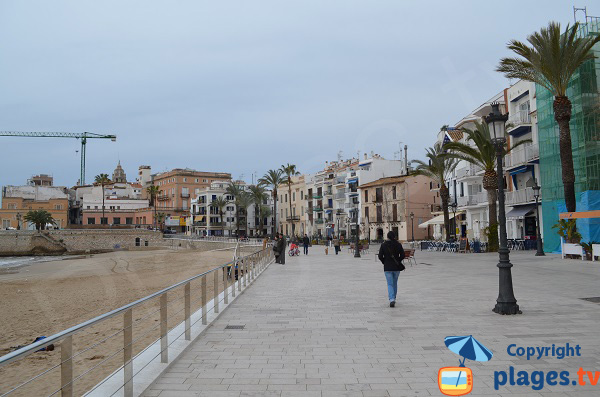 pedestrian promenade along the Sitges beach - old city